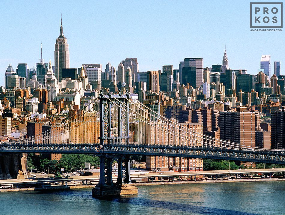 A daytime cityscape of Midtown Manhattan and the Manhattan Bridge