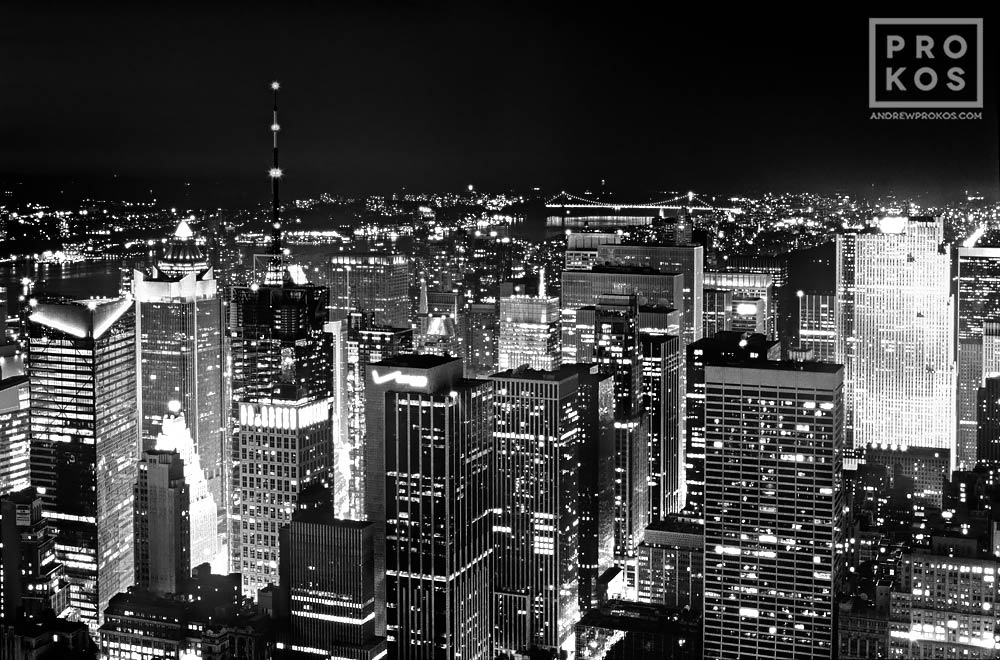 A black and white view of the skyscrapers of Midtown Manhattan at night, New York City