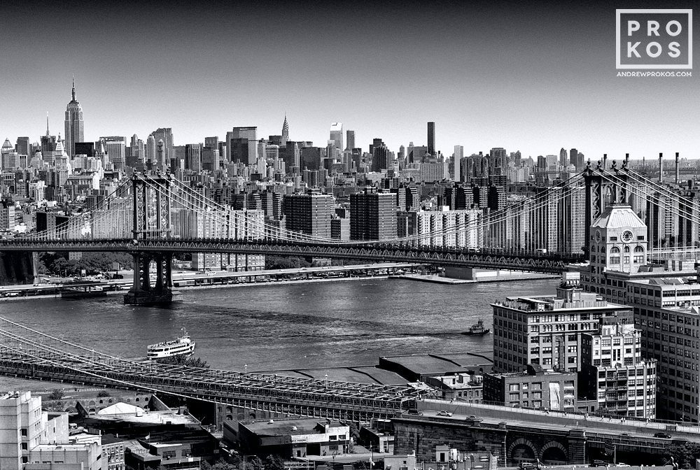 An aerial view of Midtown Manhattan and the Manhattan Bridge in black and white, New York City