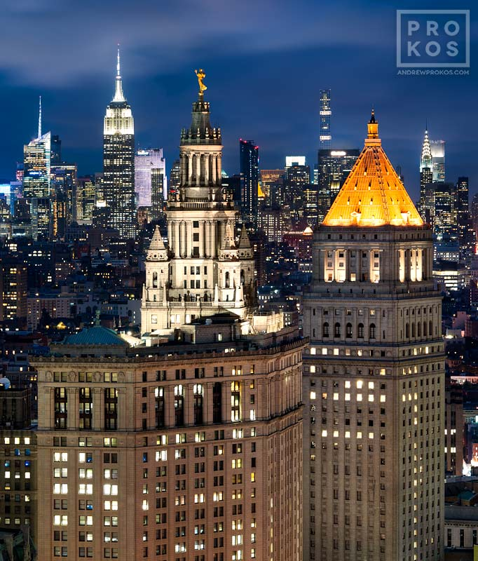 The Municipal Building and 40 Centre Street at dusk, with the skyscrapers of Midtown Manhattan and the Empire State Building in the distance, New York City
