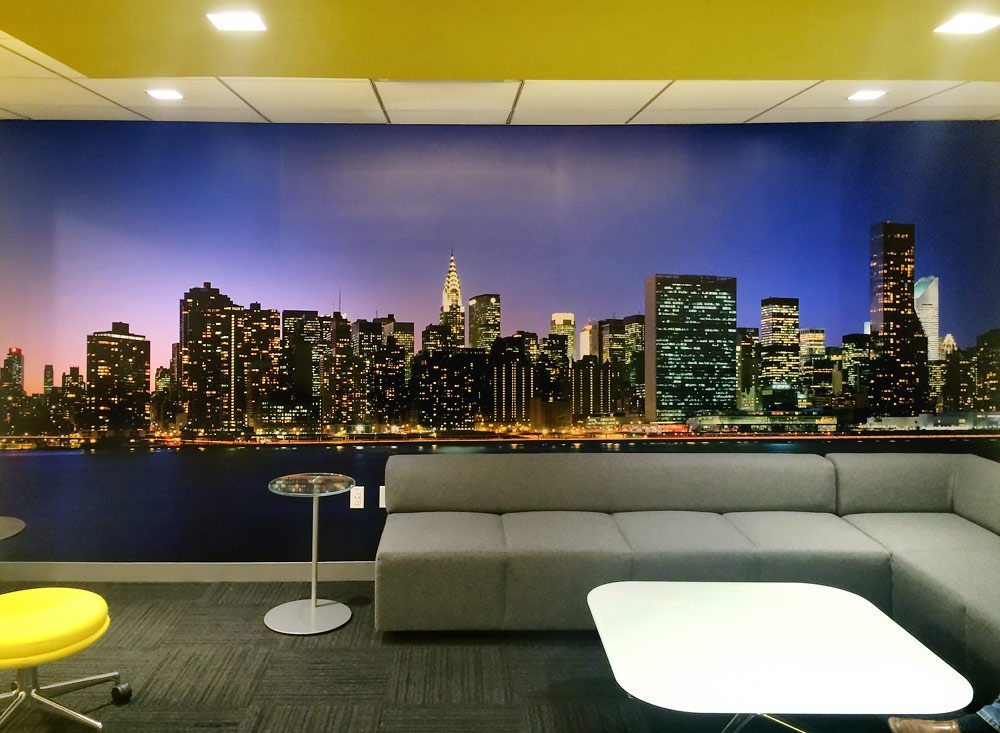 Wall mural of New York City panoramic skyline at night by photographer Andrew Prokos