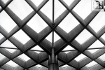 An architectural detail from the glass and steel roof which covers Kogod Courtyard, located between the National Portrait Gallery and the Smithsonian Museum of American Art, Washington DC.