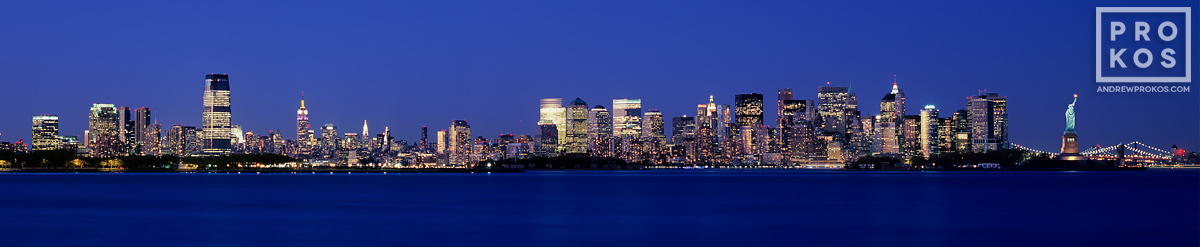 A panorama of New York City and NY Harbor at night as seen from New Jersey