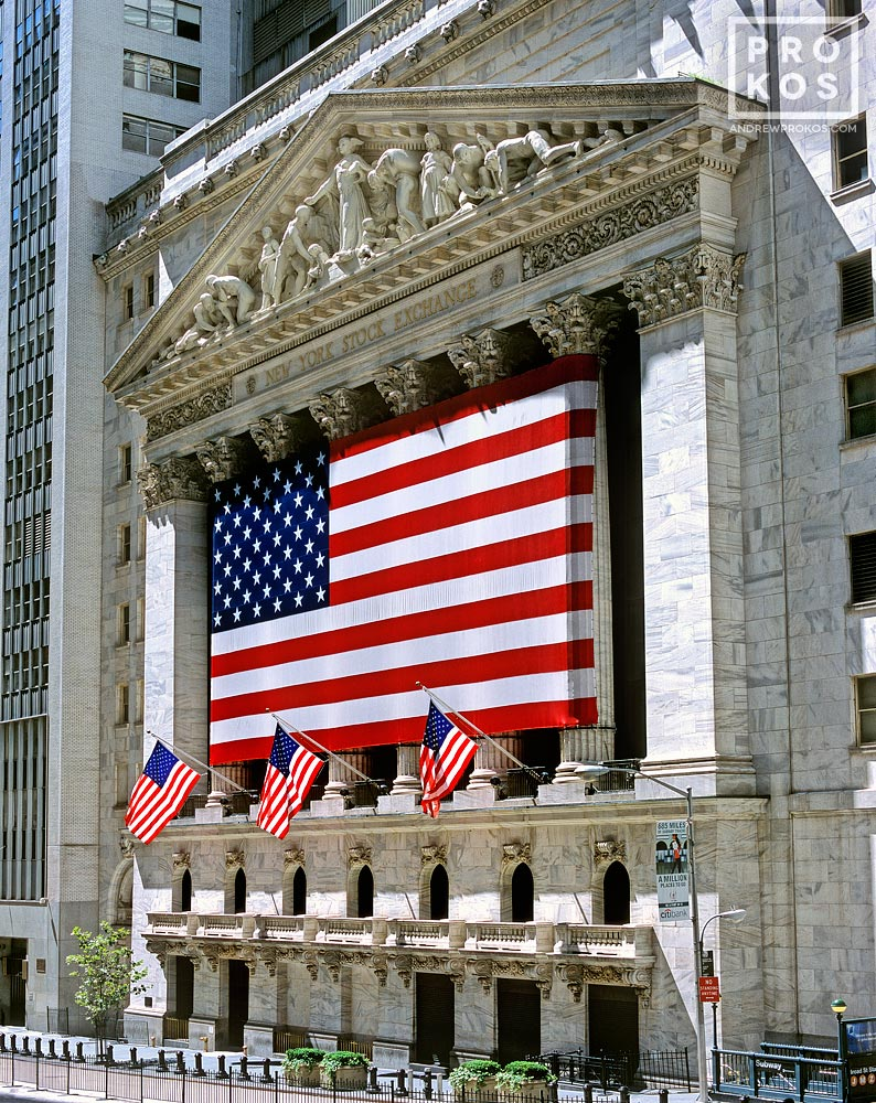 A view of the New York Stock Exchange (NYSE) and American flags
