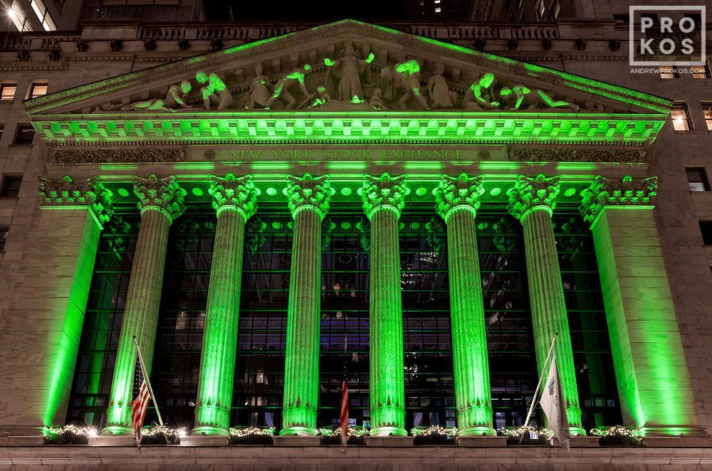 A view of the illuminated facade of the New York Stock Exchange (NYSE) at night