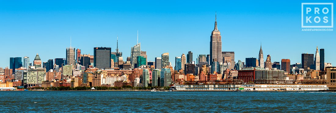 A panoramic skyline of New York City and the Hudson River as seen from New Jersey during the day