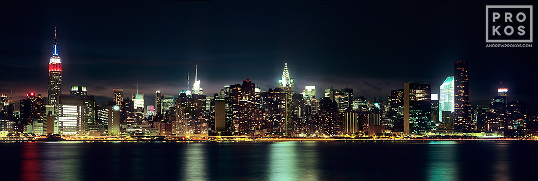 A panoramic skyline of New York as seen from Brooklyn at night, New York City