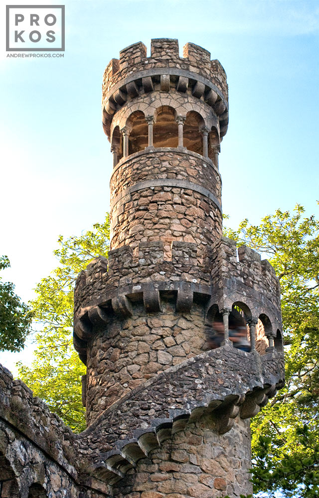 An exterior view of the tower of the Poco Iniciatico, a hidden well with arched spiral stairway in the Quinta da Regaleira gardens of Sintra, Portugal