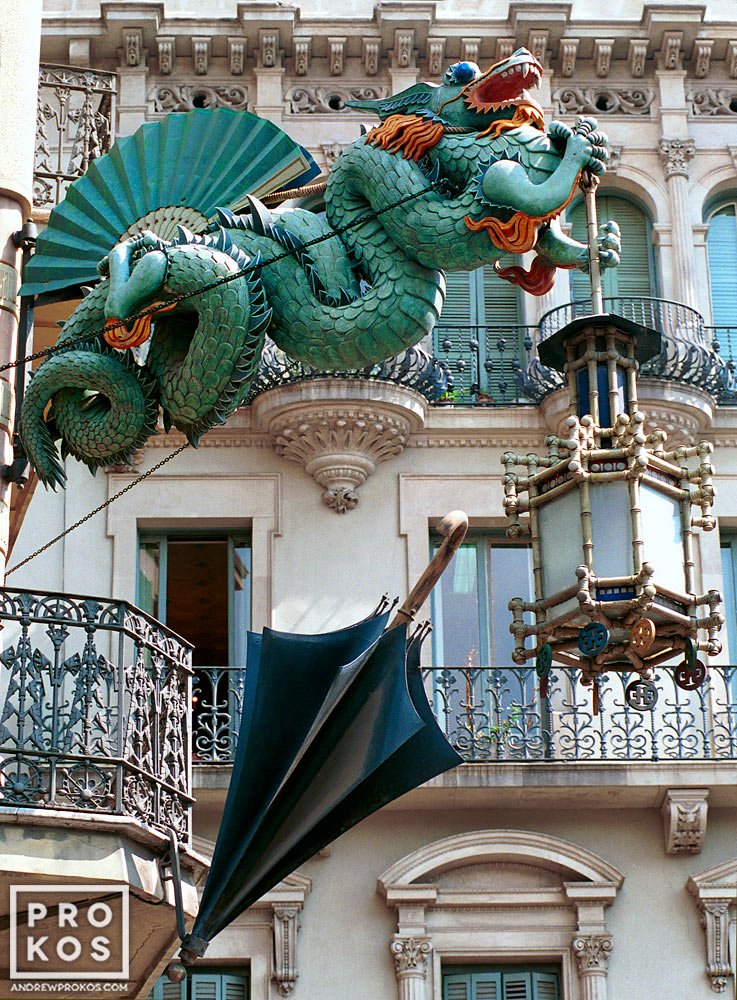 The famous cast iron dragon on the facade of a former umbrella shop, Las Ramblas, Barcelona, Spain