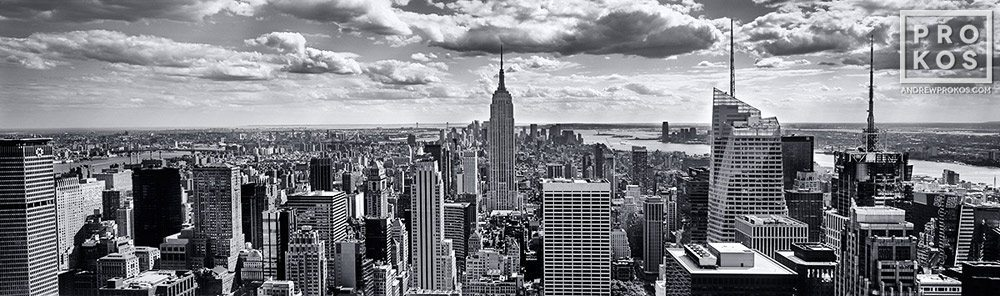A black and white panorama of New York City and the Empire State Building as seen from Rockefeller Center