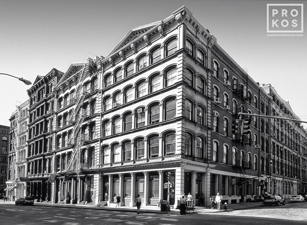 A black and white view of the intersection of Broome and Wooster streets in Soho, New York City