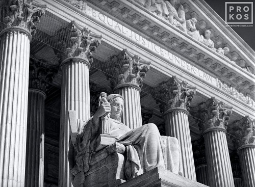 Facade of the US Supreme Court in black and white, with the Contemplation of Justice statue in the foreground, Washington DC
