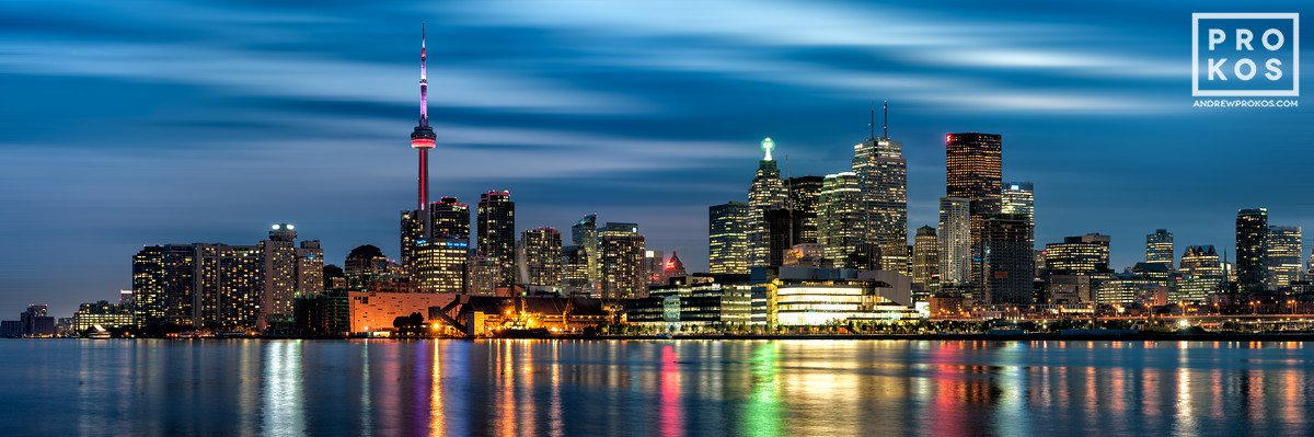 A panoramic skyline of Toronto, Canada at dusk.