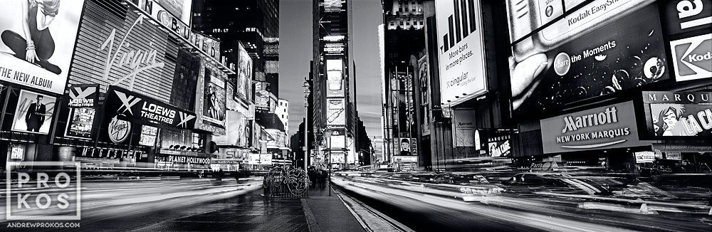 A high definition panoramic view of Times Square at dusk in black and white, New York City. This photo is available as a gallery-quality fine art print framed in various styles.