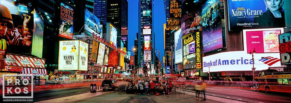 A panoramic view of the signs of Times Square at dusk, New York City