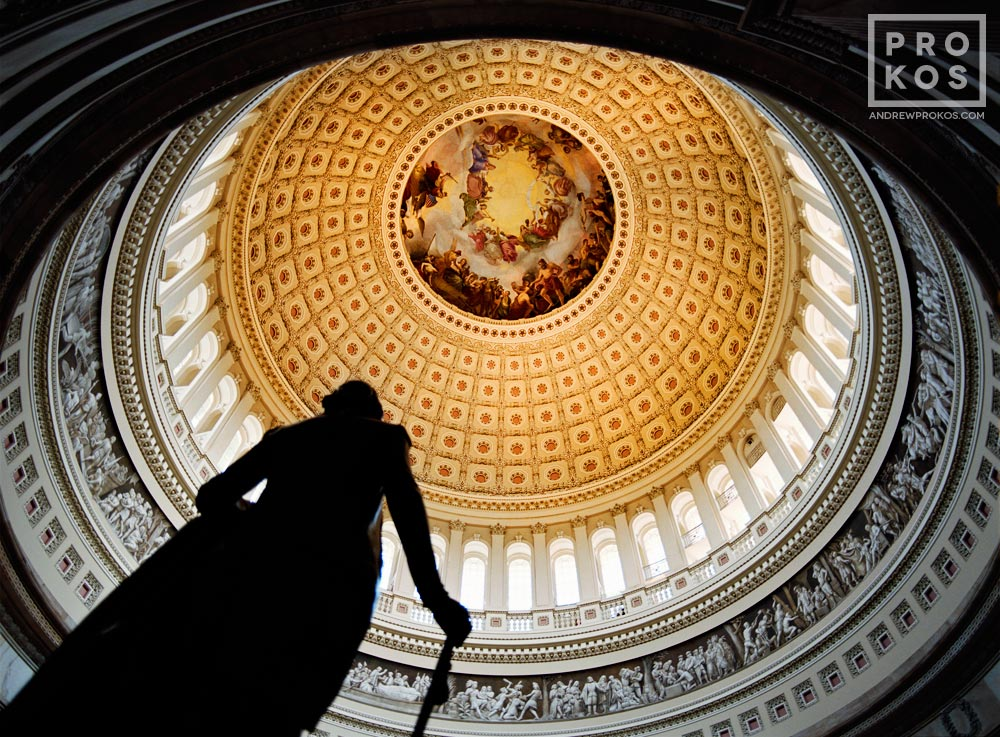 The rotunda of the U.S. Capitol building with statue of George Washington, Washington D.C.