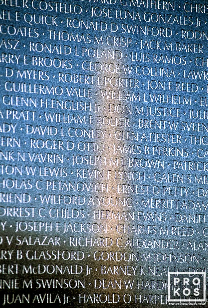 A photo of the names inscibed on the Vietnam Veteran's Memorial, Washington DC