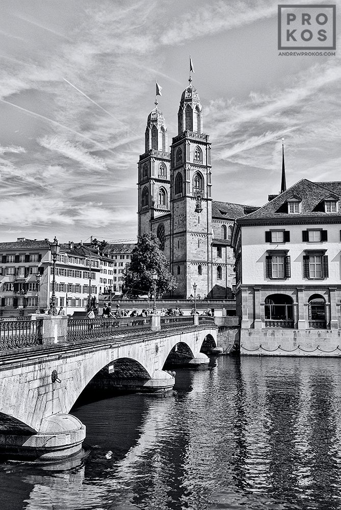 A view of Grossmünster Cathedral and the Münsterbrücke as seen from the Limmat River, Zurich, Switzerland.