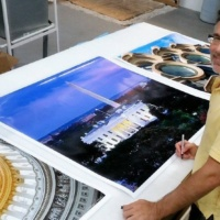 Photographer Andrew Prokos signing large scale fine art prints of Washington DC for Hyatt Hotels.