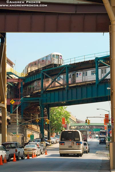 A bi-level subway train overpass in Long Island City.