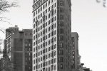 A view of the Flatiron Building from Fifth Avenue in black and white, New York City
