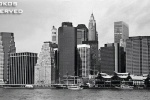 A black and white panoramic skyline of Lower Manhattan as seen from Brooklyn, New York City