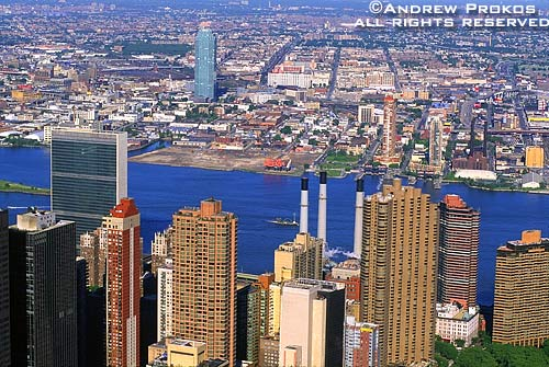 An aerial view of East Midtown Manhattan, the East River and Queens, New York City