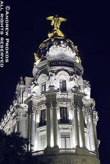 The landmark Metropolis Building at night, Madrid, Spain