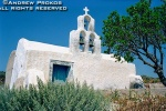 A rustic whitewashed chapel with campanile in the interior of the island of Santorini, Greece
