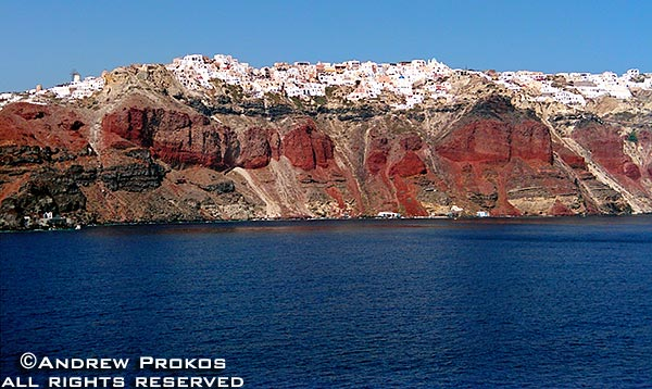 A view of the colorful cliffs of Santorini, Greece and its main town Thira from the sea