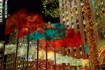 A night photo of Rockefeller Center's famous Christmas lights and decorations, New York City