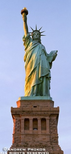 A panoramic photo of the Statue of Liberty at sunset, New York City