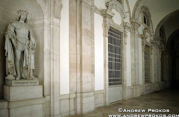 Interior of the Spanish royal palace with statue of King Ferdinand, Madrid