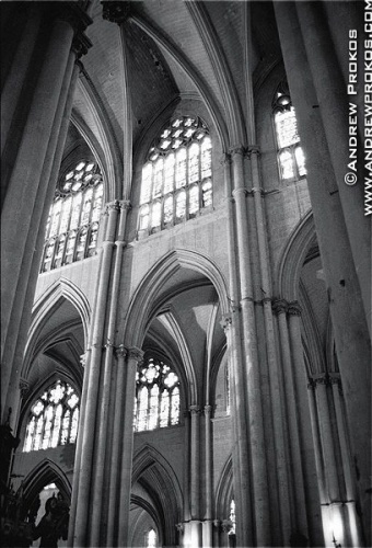 Interior of the Gothic Cathedral of Toledo, Spain in black and white