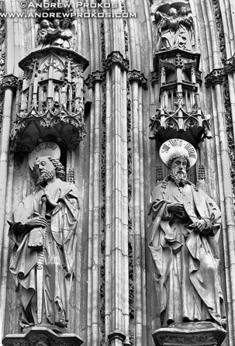 A pair of Gothic saints carved in stone on the portal of Toledo Cathedral, Spain