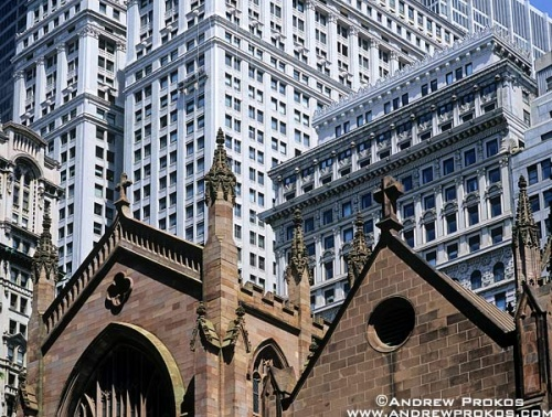 View of Trinity Church against a backdrop of high-rise buildings in New York's Financial District