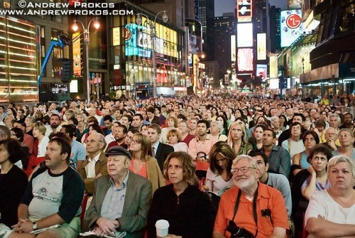 Spectators watch the opening night performance of the Metropolitan Opera in Times Square