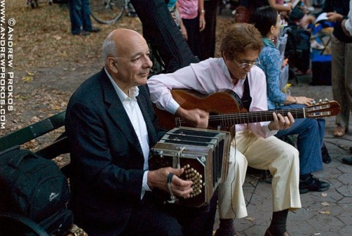 Tango musicians playing the bandoleon and guitar in Central Park, NYC