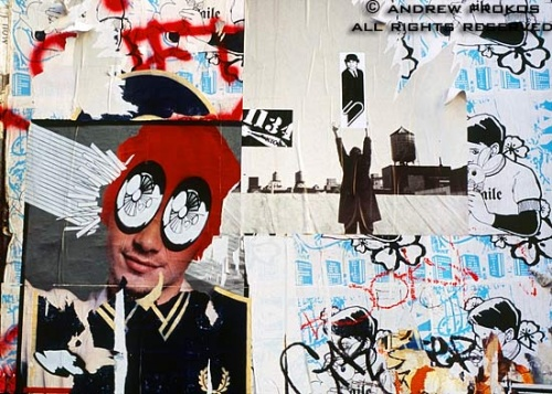 Graffiti and posters decorate a wall in Soho, New York City