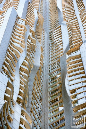 An architectural detail photograph of the warped facade of 8 Spruce Street by Gehry Partners, Manhattan, New York City. Fine art prints of this photo are available framed in various styles.