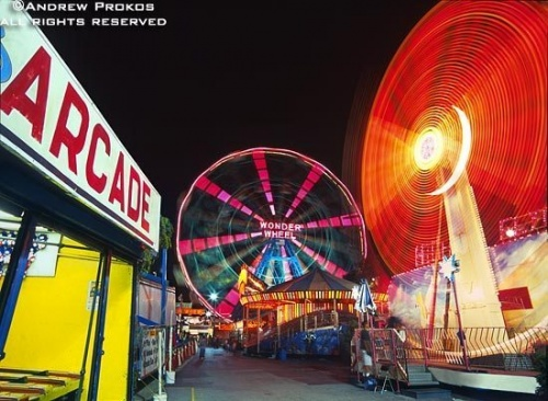 Rides in motion at Coney Island's arcade at night, Brooklyn, New York