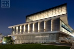 An exterior view of the Acropolis Museum in Athens, Greece at night. Bernard Tschumi Architect.
