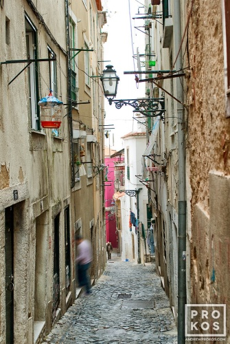 A fine art street scene photo of an alley in the Alfama district of Lisbon, Portugal.