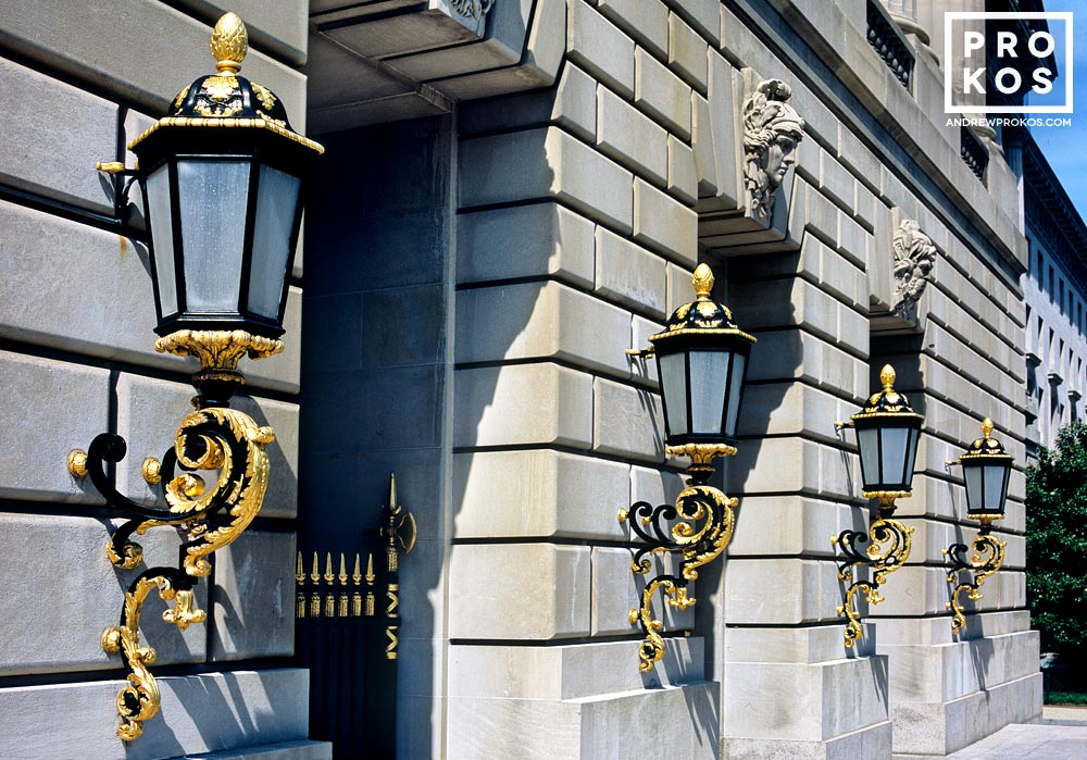 A color architectural photo of the ornate lamps from the exterior of the Mellon Auditorium building in Washington DC