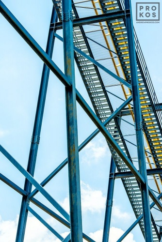 "A view of the steel girders under the Nitro amusement park ride, from the fine art architectural photo series ""The Architecture of Amusement"""
