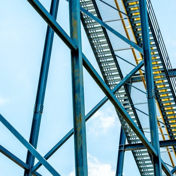 A view of the steel girders under the Nitro amusement park ride, from the fine art architectural photo series