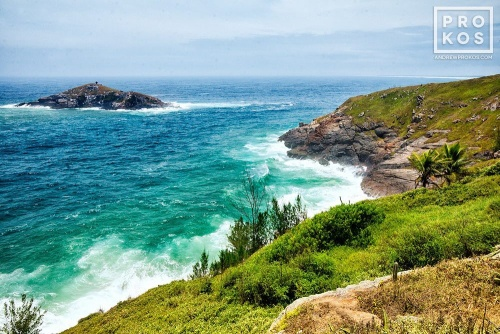 A landscape photo showing the cliffs of Arraial do Cabo, Brazil and the Atlantic Ocean.