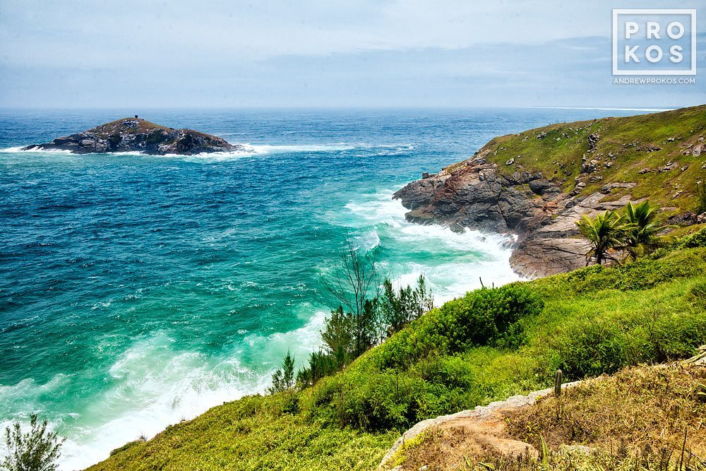 A landscape showing the cliffs of Arraial do Cabo, Brazil and the Atlantic Ocean.