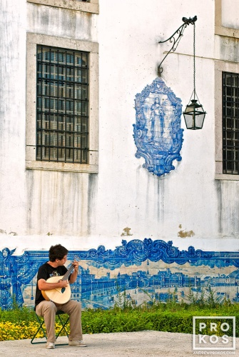 A fine art photo of street guitarist playing a mandolin in the Alfama district of Lisbon, Portugal
