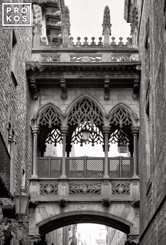 A black and white fine art photo of Bridge of Sighs, in the Gothic Quarter of Barcelona, Spain